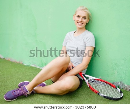 Girl tennis player on the court with a racket. Athletic, health, sports, lifestyle. - stock photo