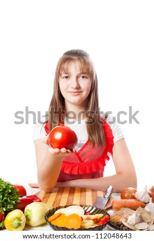 girl the cook offers a ripe red tomato