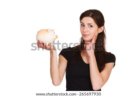 girl thinks about saving money with moneybox - stock photo