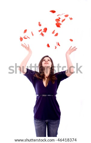 Girl throwing some rose petals isolated over white background