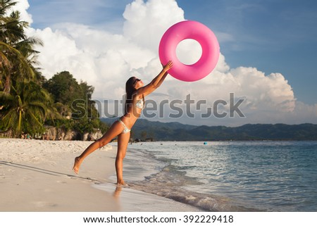 Girl throws a floating tube