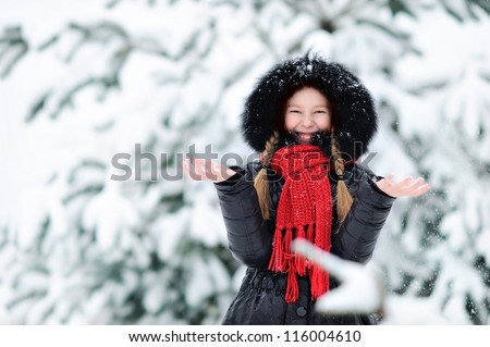 Girl throws snow - stock photo