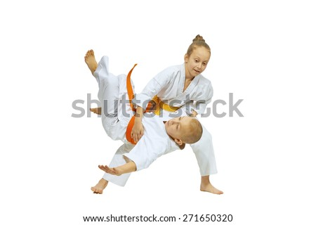 Girl throws the boy through the thigh on the mat - stock photo