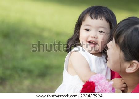 Girl to be hug to mother - stock photo