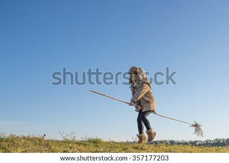 Girl to fly aboard the broom