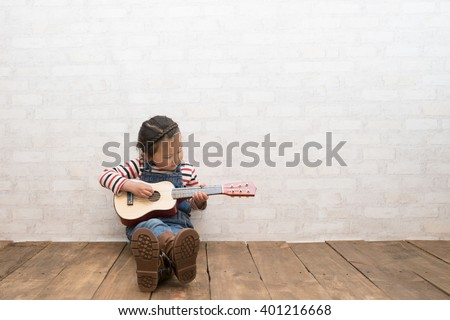 Girl to play the guitar - stock photo