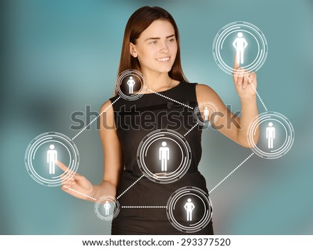 Girl touches the human icons and gears. - stock photo