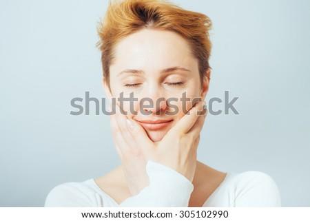 girl touches the skin - stock photo