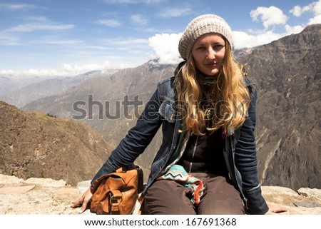 Girl tourist looks at Colca Canyon in Peru - stock photo