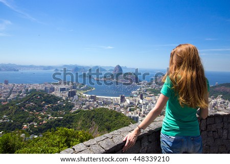 girl tourist  looks at Rio landscape and the Pao do Asucar