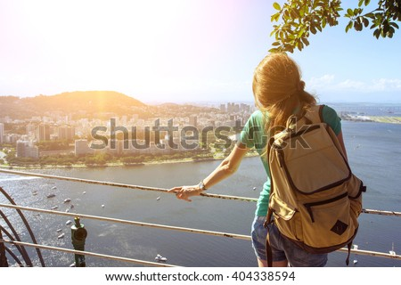 girl tourist with a backpack on the background Rio de Janeiro. view from Pao de Acucar - stock photo
