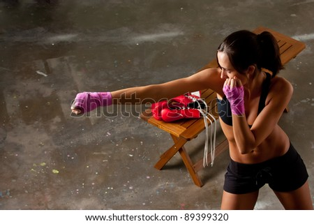 Girl training body combat - stock photo