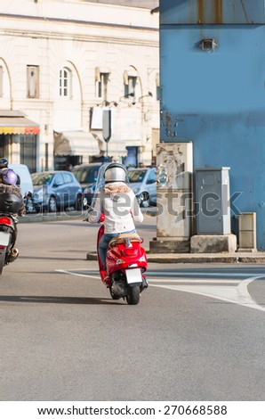 girl traveling by a motorbike in genoa - stock photo