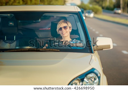 Girl travels by car - stock photo