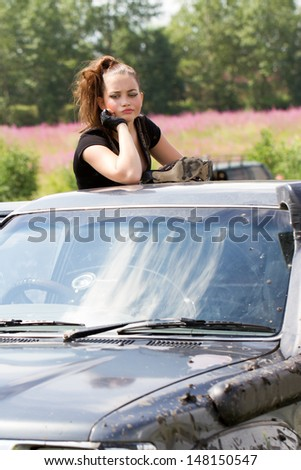 Girl trying to get out of the car got stuck in the mud