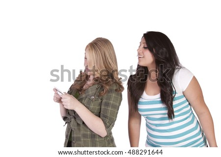 Girl trying to look at her friend's text message