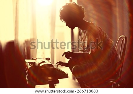 girl typing on a typewriter - stock photo