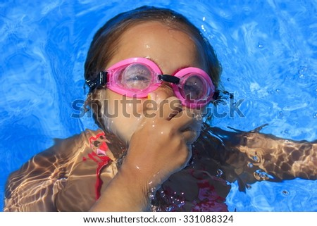Girl underwater - stock photo