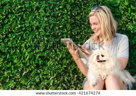 Girl using a digital tablet outdoors - stock photo