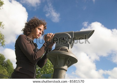 Girl using pay-to-use telescope