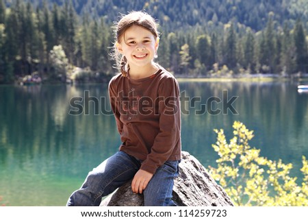 Girl visiting the Hintersee, Berchtesgadener Land, Bavaria, Germany