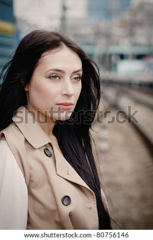 girl waiting for train on platform