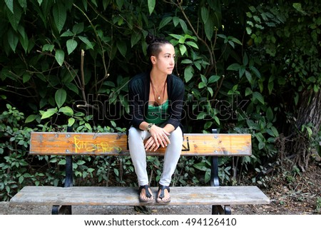Girl waiting in a park