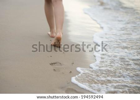 girl walk on the beach - stock photo