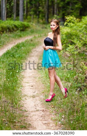 Girl walking at forest road. - stock photo