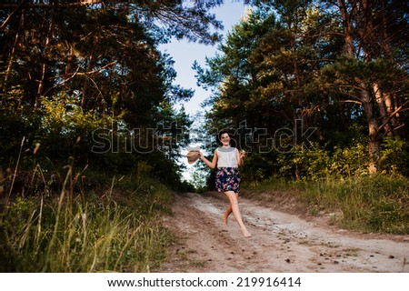 girl walking in a pine forest