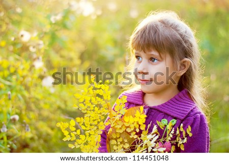Girl walking in autumn forest - stock photo