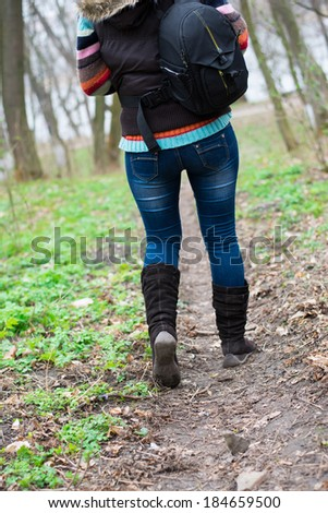girl walking in the woods - stock photo
