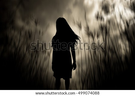 Girl walking in the woods,Horror Background For Halloween Concept And Movie Poster Project