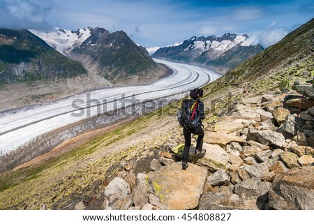 Girl walking on spectacular mountain scenery, Alps, Switzerland.