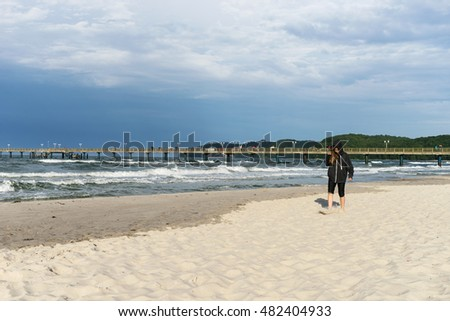 Girl walking on the Baltic Sea beach / walk on the beach / at the Baltic Sea