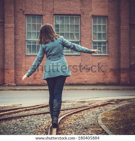 girl walking on the railway - stock photo