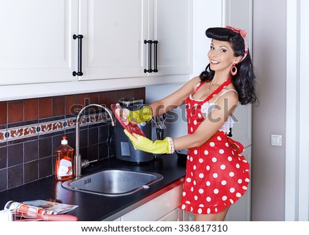 Girl washes dishes - stock photo