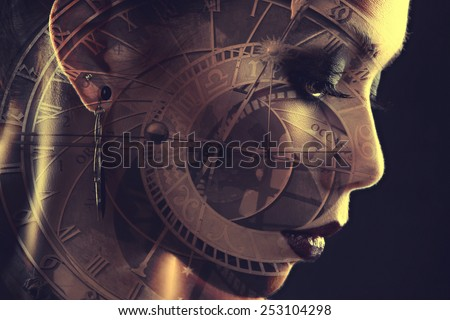 girl watches. Mystical image of time. Alchemical processes of aging. Photo with double exposure - stock photo