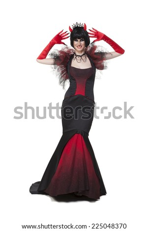 Girl wearing a halloween party and carnival red and black devil costume on white - stock photo