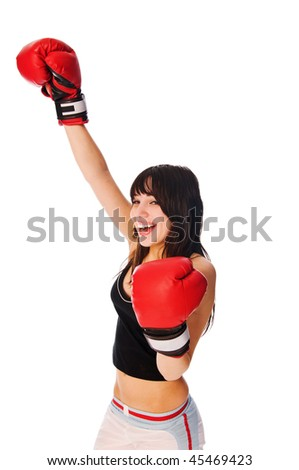 Girl wearing boxing gloves with a rised hand on white
