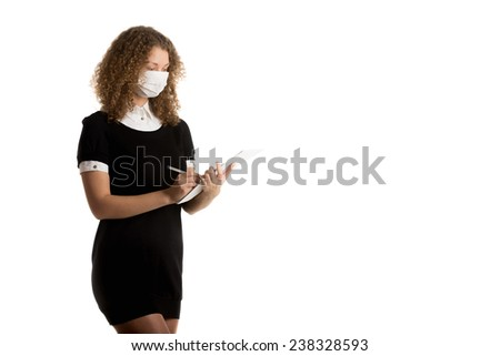 Girl wearing face mask and office uniform is writing   documents with space for text
