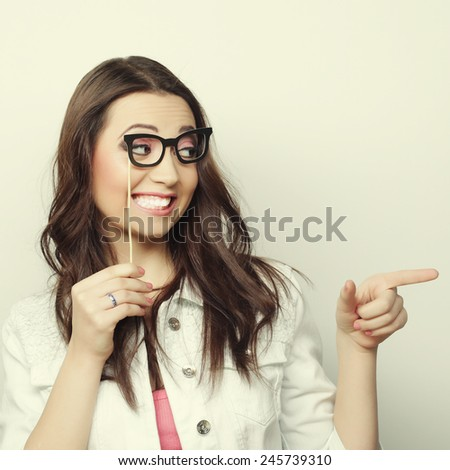Girl wearing fake mustaches. Ready for party - stock photo