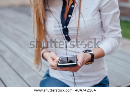 Girl wearing headphones and listening to music. Close up - stock photo