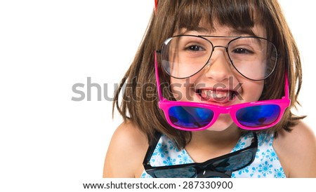 Girl wearing many sunglasses