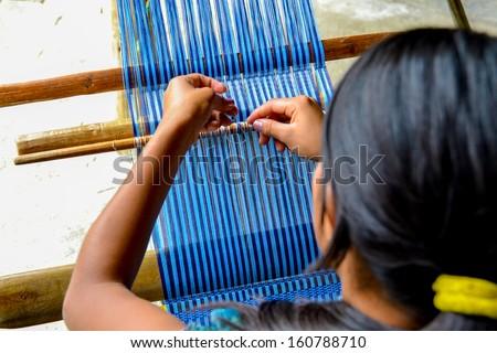 Girl weaving Guatemala - stock photo