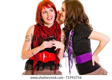 Girl whispering gossips in  ear her interested girlfriend isolated on white - stock photo