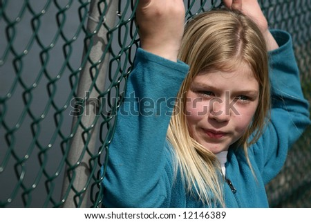 Girl who feels she is up against a wall. - stock photo