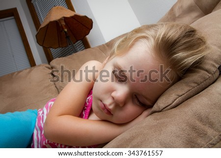 Girl who fell asleep on the couch at night time