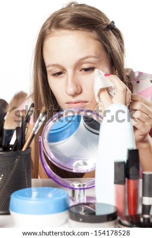 girl wipes mascara and eye make-up using wet wipes before bedtime