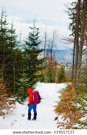 girl with a backpack in the woods, travel and sports.